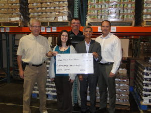 The Agribusiness CHS presented a check to Great Plains Food Bank in Fargo on June 6, 2016
